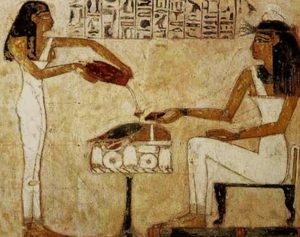 Egyptian woman pouring beer